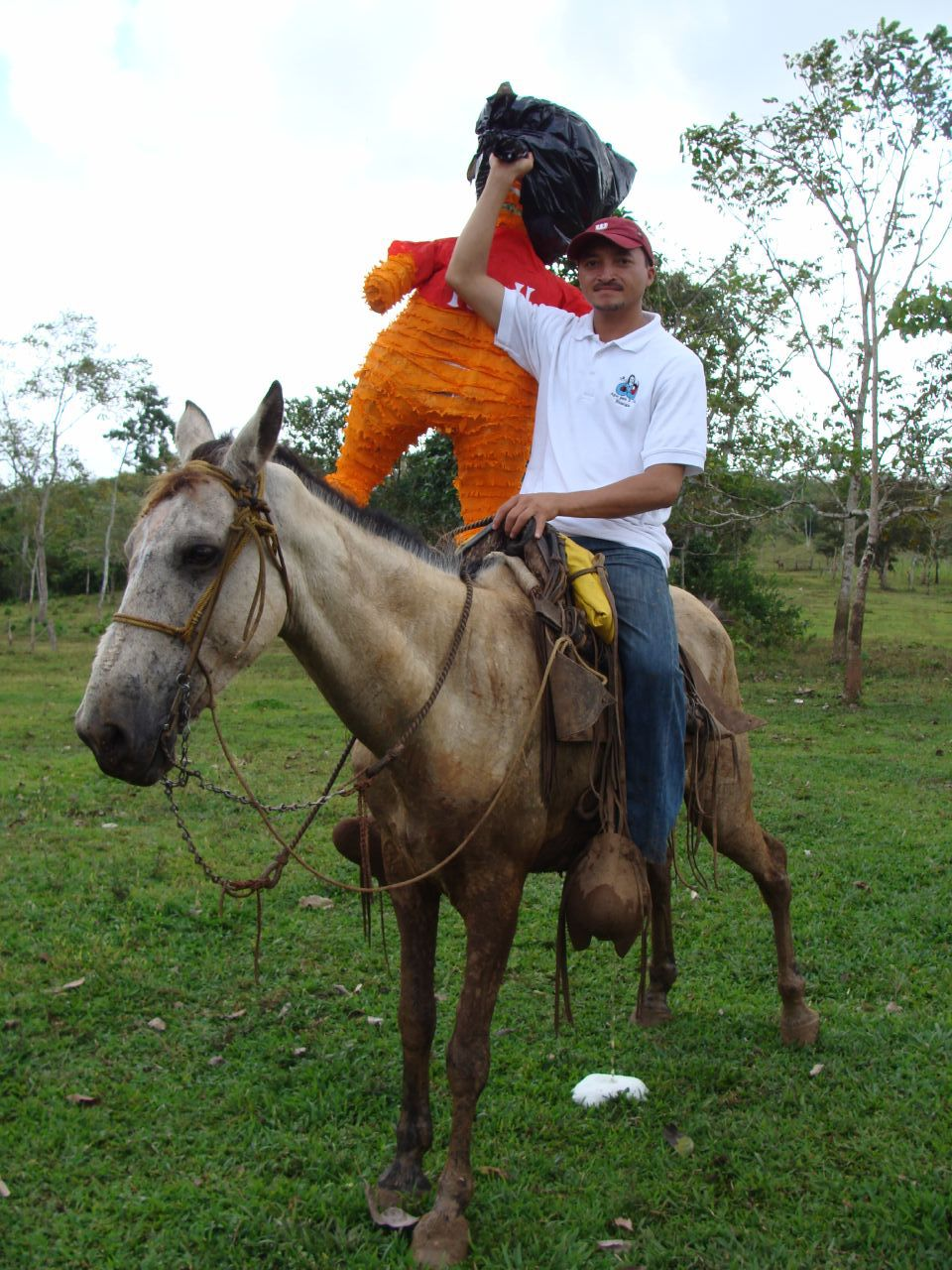 Fadir taking the piñata on horseback up to the ribbon-cutting ceremony at Okawas