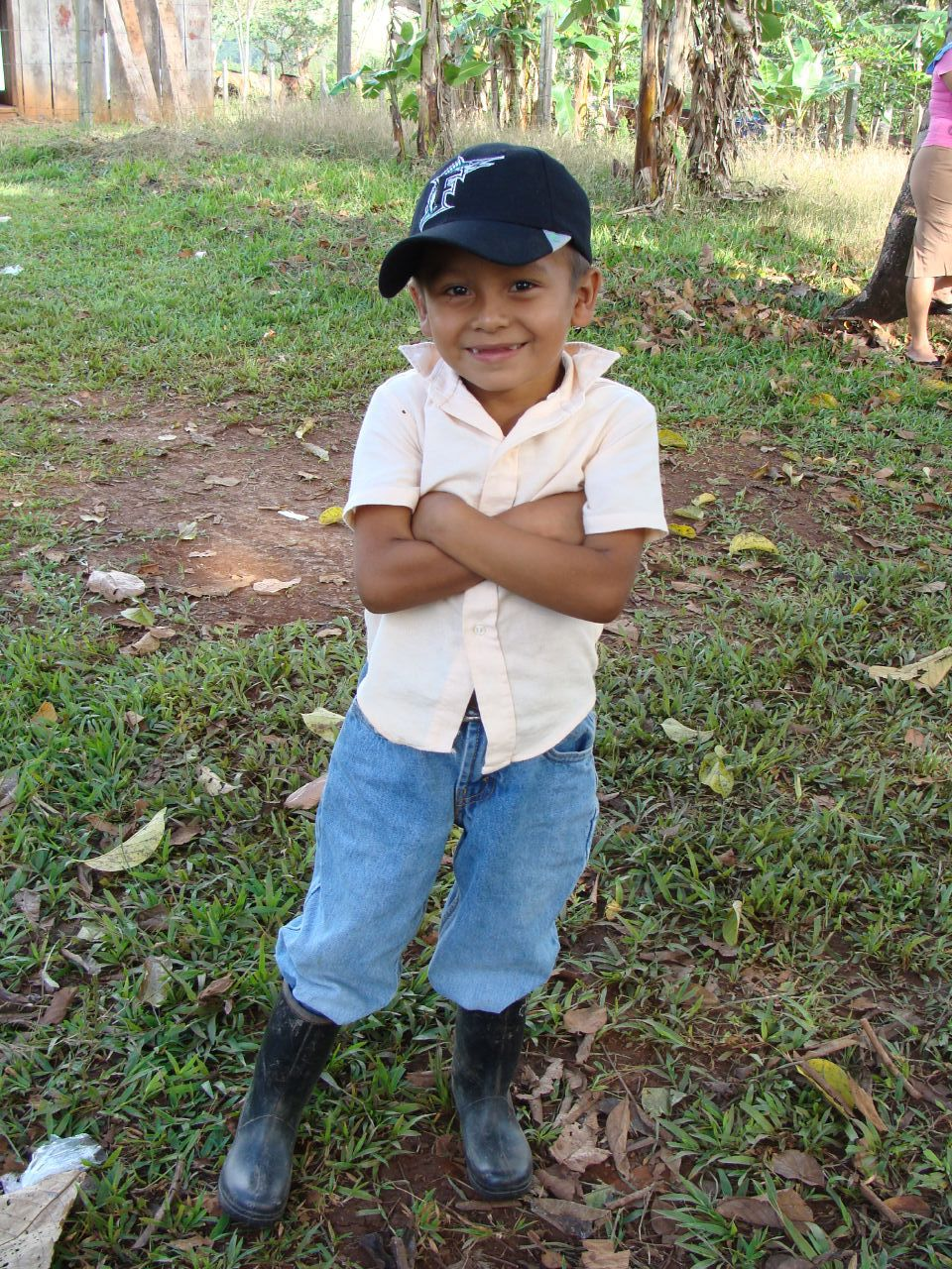 A happy boy (with his standard Central American rubber boots) at the Okawas celebration